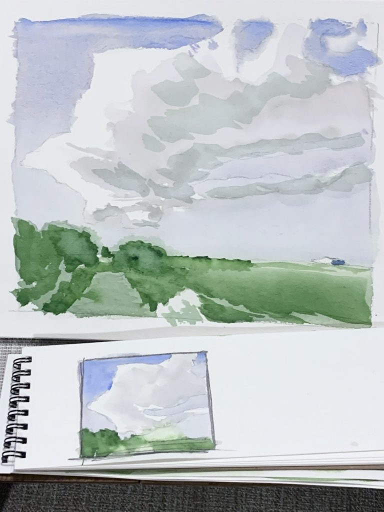 photograph of 2 small watercolour landscape paintings